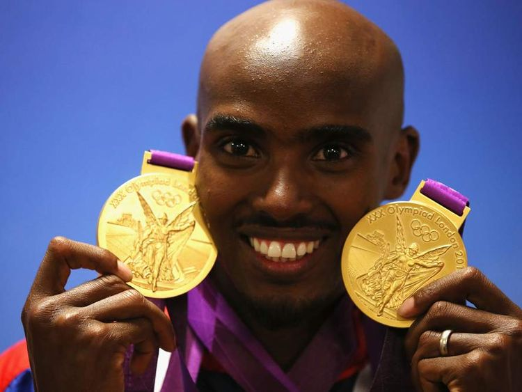 Mo Farah clutches his 5,000, and 10,000m Olympic medals in 2012