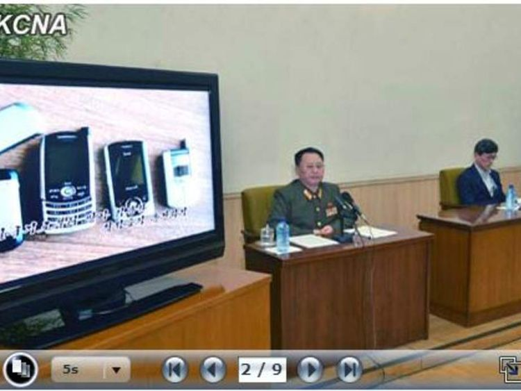 Mobile phones are shown to the press conference as evidence of spying