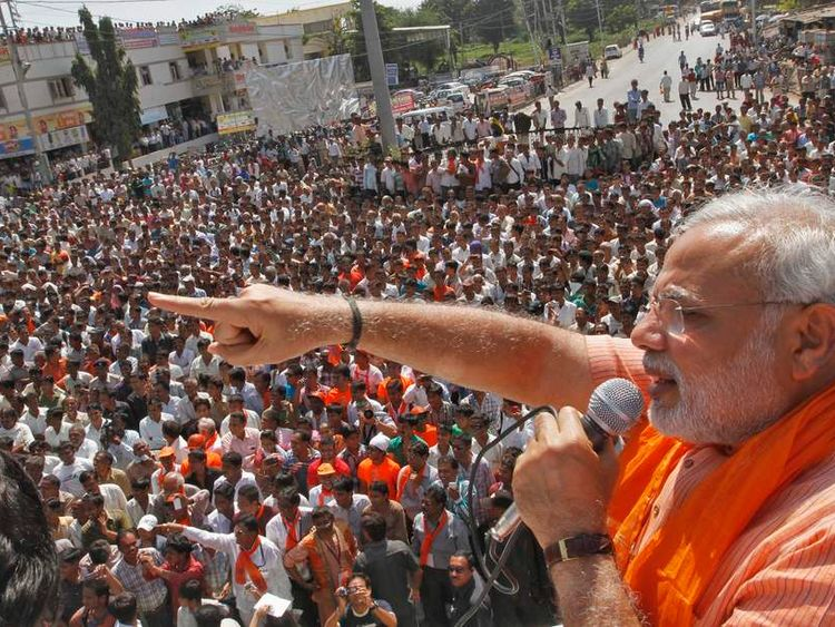 Gujarat's CM Modi addresses his supporters during an election campaign rally ahead of the state assembly elections at Dokar village in Gujarat