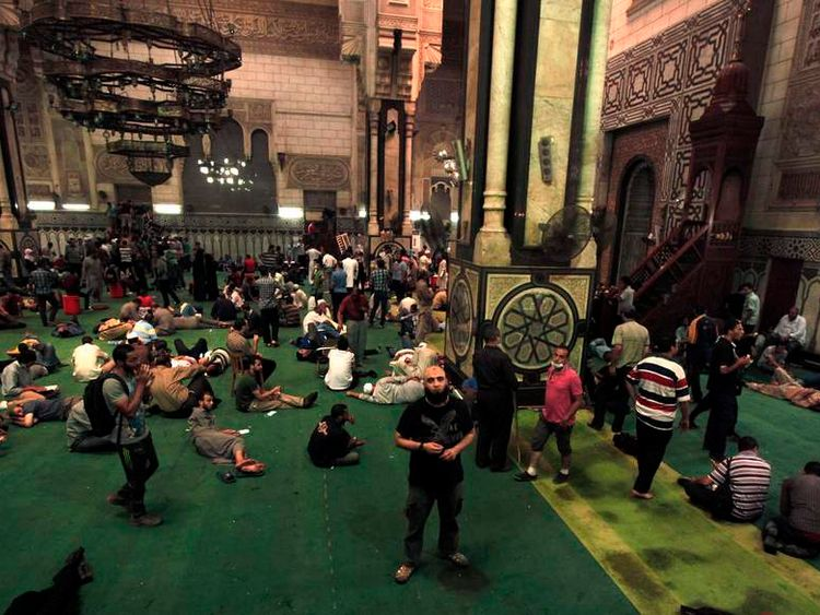 Demonstrators who support ousted Egyptian President Mohamed Mursi wait inside al-Fath mosque at Ramses Square in Cairo