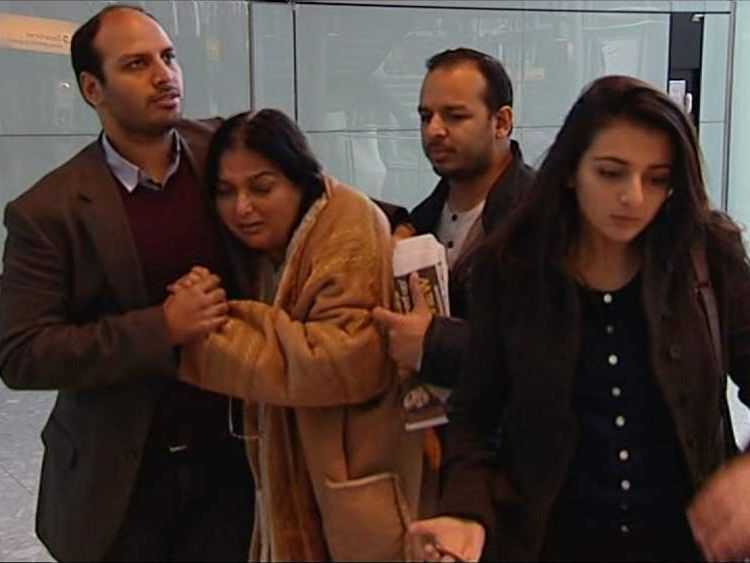 Fatima Khan is consoled by her sons Shahnawaz (L), Afroze (R) and daughter Sara Khan