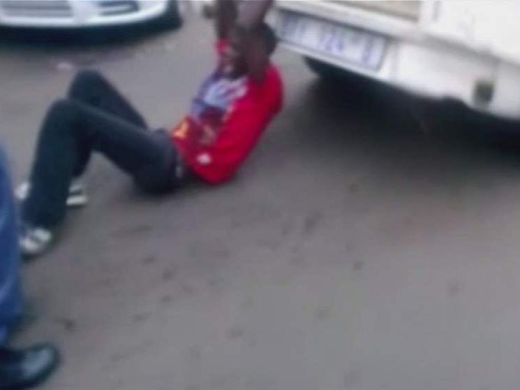 South Africa man chained to and dragged behind police van