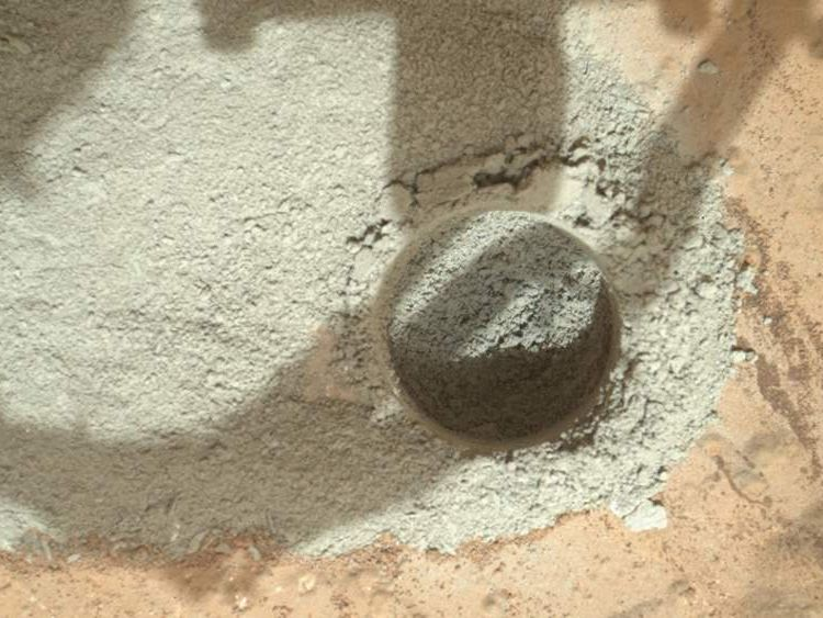 Powdered rock left at the drill site