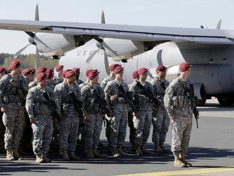 First company-sized contingent of about 150 U.S. paratroopers from the U.S. Army's 173rd Infantry Brigade Combat Team based in Italy attend a welcome ceremony in the airport in Riga