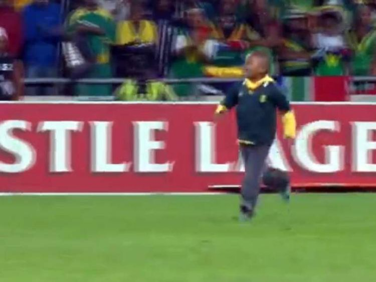 The little boy runs onto the pitch