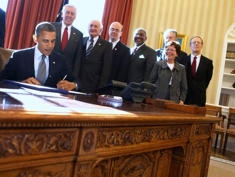 President Barack Obama signs the Magnitsky Act into law