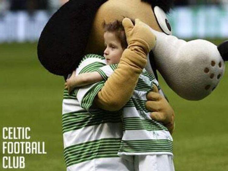Oscar hugs the Celtic mascot