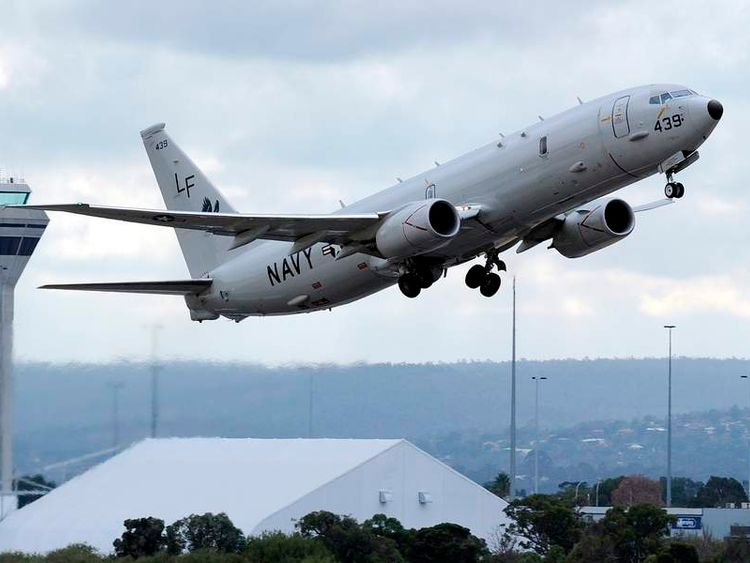 A US Navy P-8 Poseidon aircraft takes off from Perth International Airport