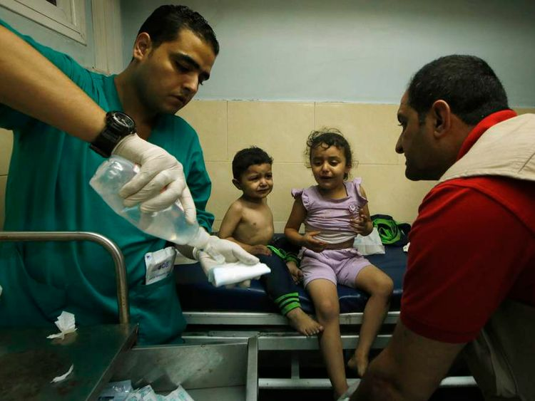 Palestinian children, who hospital officials said were wounded in an Israeli air strike, receive treatment at a hospital in Gaza City