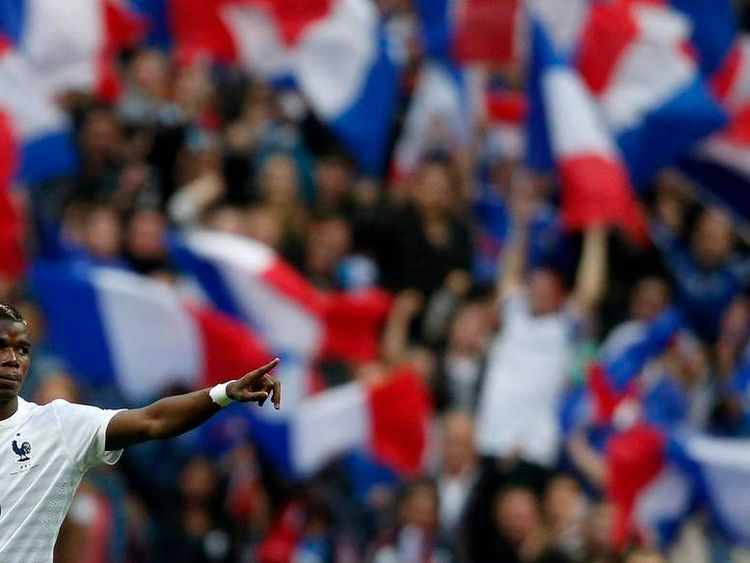 France's Pogba celebrates after scoring the first goal for the team during their international friendly soccer match against Norway at the Stade de France Stadium in Saint-Denis