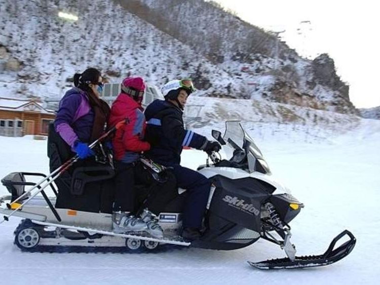 North Koreans riding a ski-doo at the country's first ski resort.