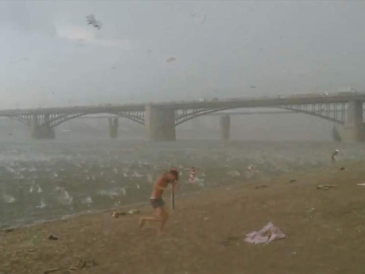 Hailstone storm batters sunbathers