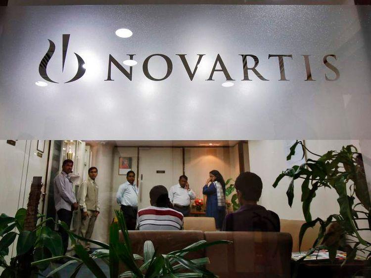 People gather at Novartis India headquarters in Mumbai