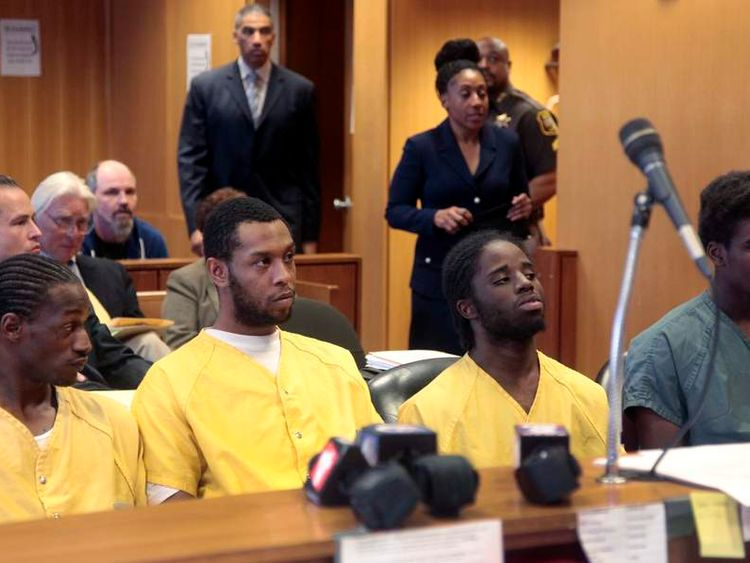 Wonzy Saffold, James Davis, Latrez Cummings and Bruce Wimbush Jr., sit in court during their preliminary examination in Detroit