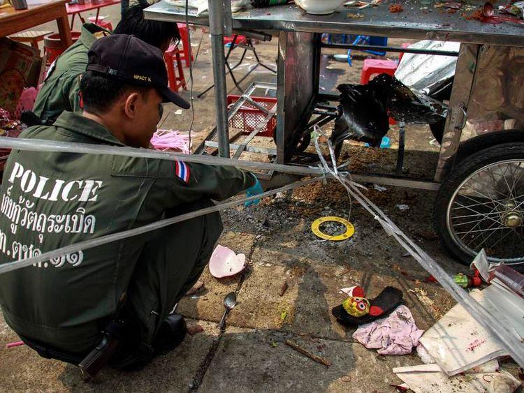 Police investigate the scene of the attack