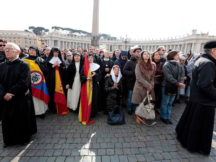 Nuns and pilgrims pray as Pope Benedict XVI leads his last Sunday Angelus before stepping down in Saint Peter's Square at the Vatican