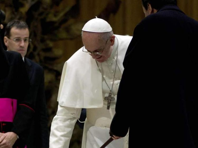 Pope pats guide dog