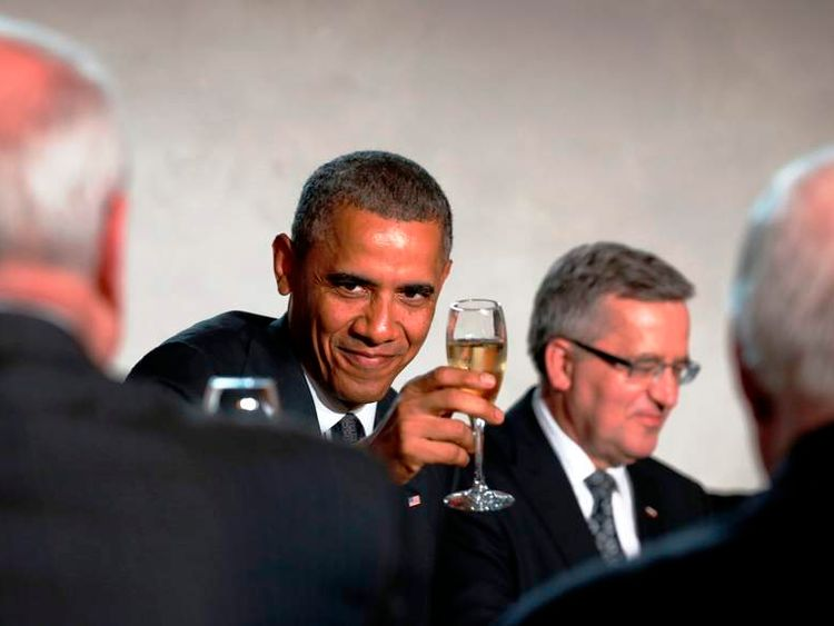 President Obama  raises his glass in a toast during the Solidarity Dinner at the Royal Palace in Warsaw