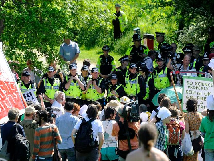 Police officers prevent anti-GM demonstrators from reaching land surrounding Rothamsted Research in Harpenden, southern England