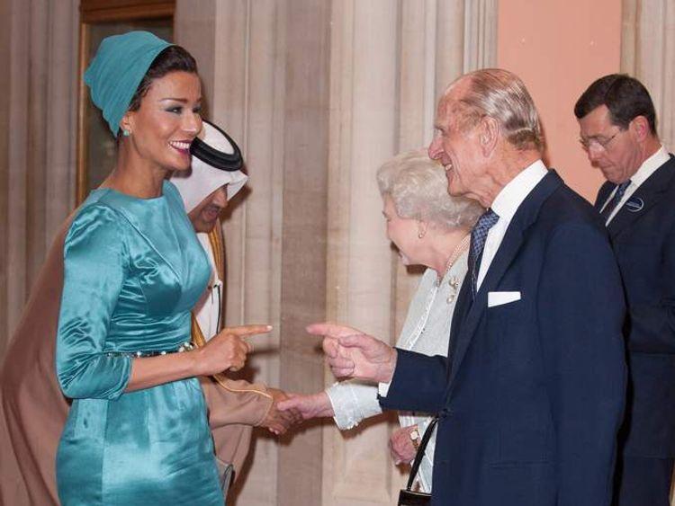 Sheika Mozah bint Nasser Al-Missned of Qatar is greeted by Queen Elizabeth II and Prince Phillip, Duke of Edinburgh