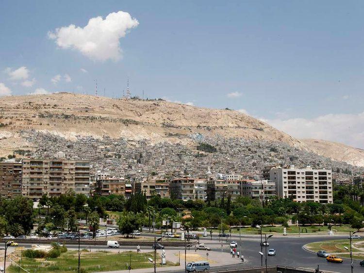 A view shows part of mount Qassioun behind Damascus city