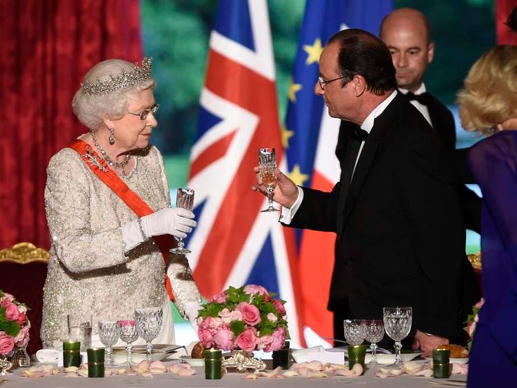 The Queen toasts with French President Hollande at a State Dinner at the Elysee Palace in Paris