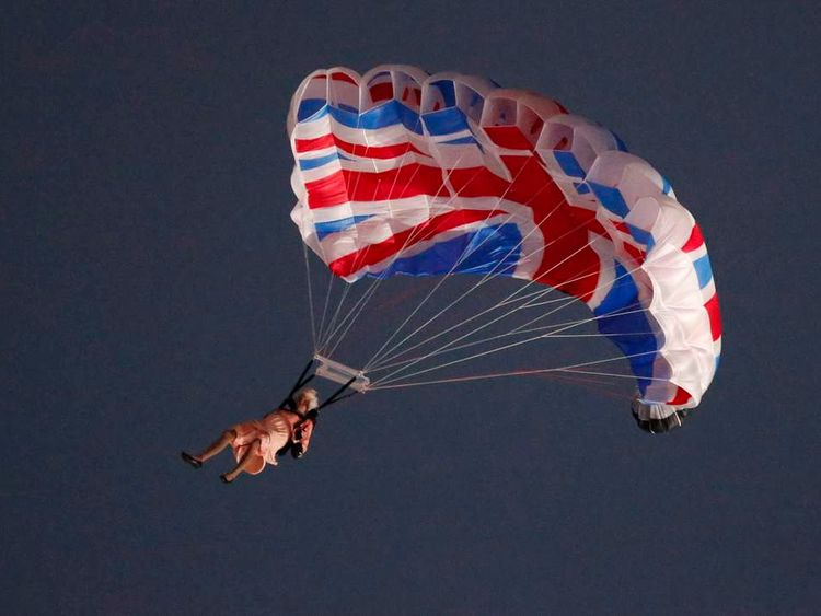 Performer plays role of Queen parachuting from helicopter into Olympic Stadium