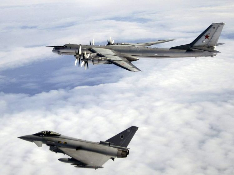 An RAF Typhoon escorts a Russian Tupolev 95 over the North Atlantic Ocean