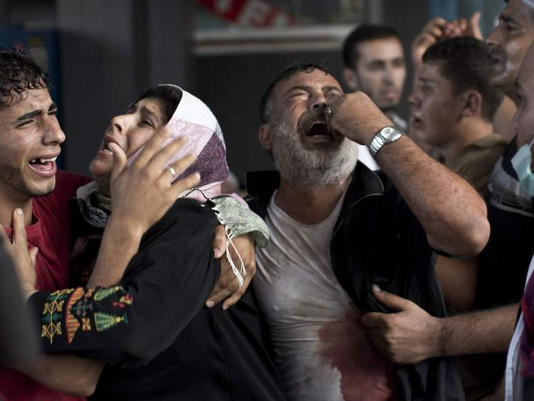 Palestinian mourners cry at Gaza City's al-Shifa hospital after an explosion killed at least seven children in a public playground in the beachfront Shati refugee camp