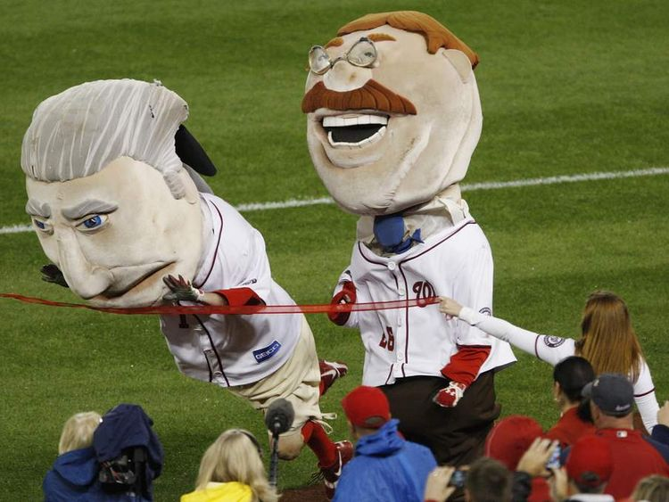 The George Washington mascot (left) dives across the line to edge out Teddy Roosevelt
