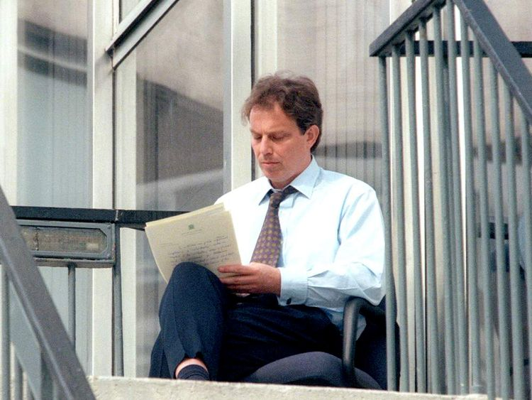Labour leader Tony Blair writes his manifesto speech on a stairway at the back entrance to the Labour Party office in London in April 1997