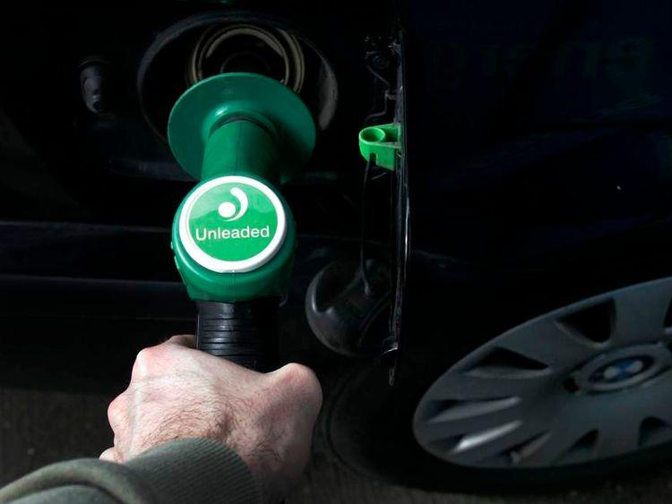 Man at a fuel pump