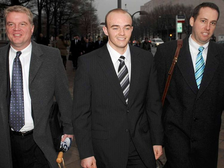 File photo of Blackwater Worldwide guard Slatten (C) and attorneys leave federal courthouse after being arraigned on manslaughter charges in Washington