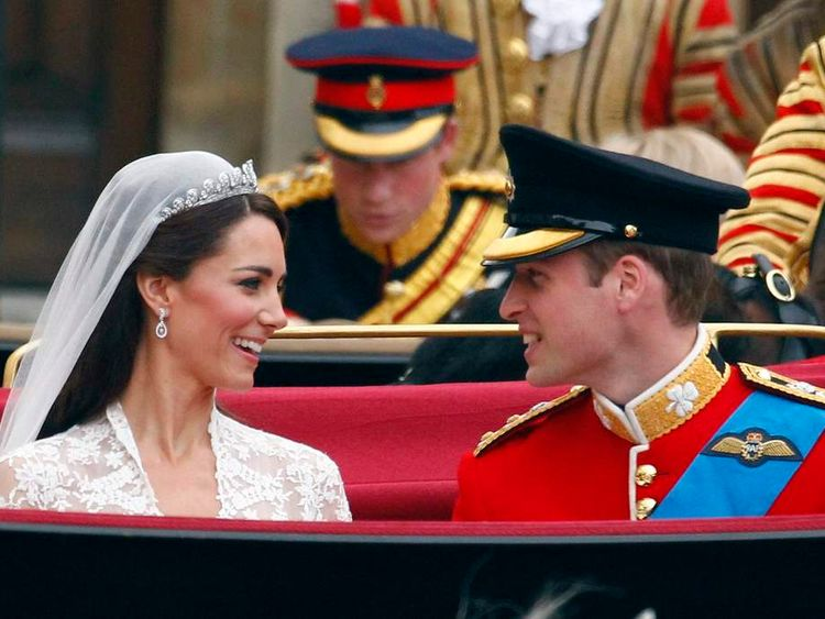 Britain's Prince William, and Catherine, Duchess of Cambridge smile as they travel to Buckingham Palace after their wedding in Westminster Abbey in London