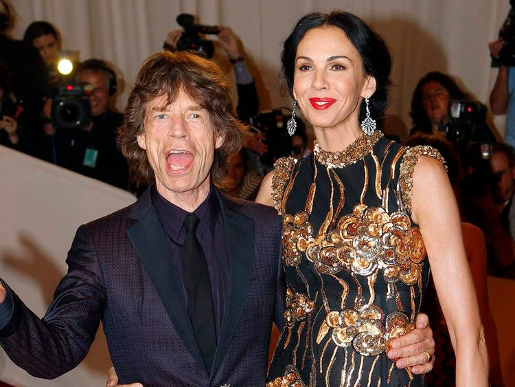 Mick Jagger and designer L'Wren Scott pose on the red carpet at the Metropolitan Museum of Art Costume Institute Benefit celebrating the opening of Alexander McQueen: Savage Beauty, in New York