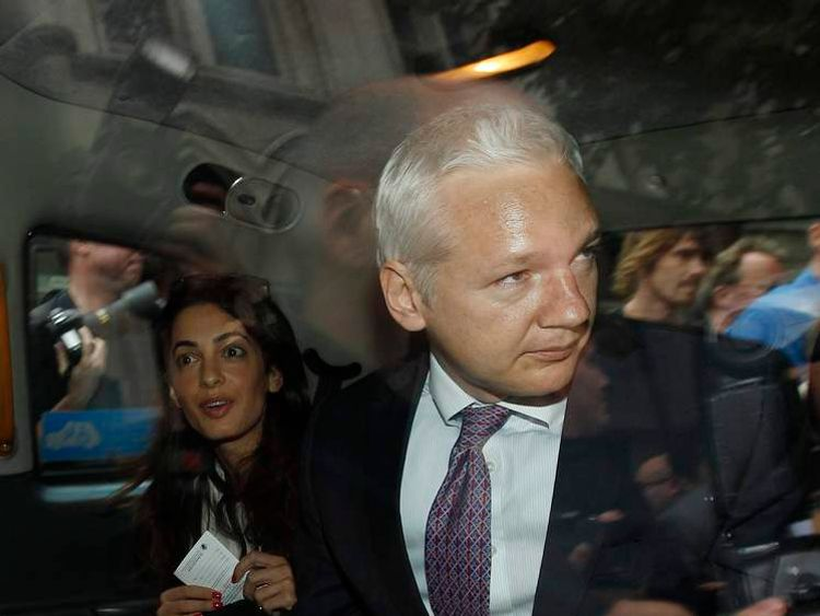 WikiLeaks founder Assange leaves the High Court in London