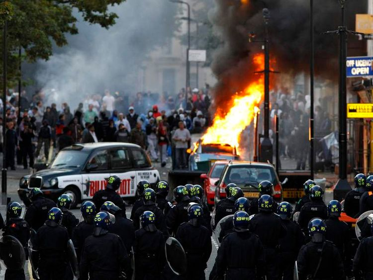 Rioters and police in Hackney, east London