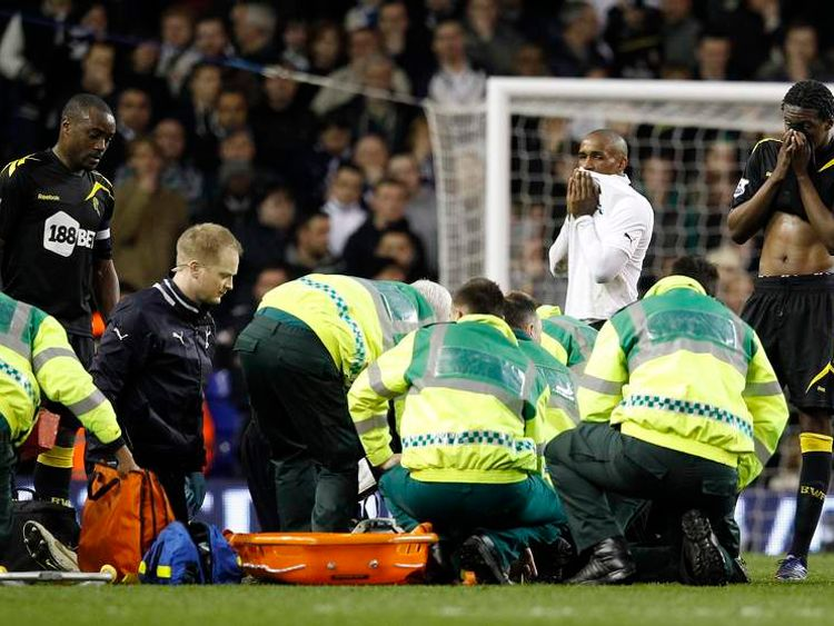Bolton Wanderers players look on as medical staff attend to Fabrice Muamba after he collapsed on the pitch during their FA Cup quarter-final soccer match against Tottenham Hotspur at White Hart Lane