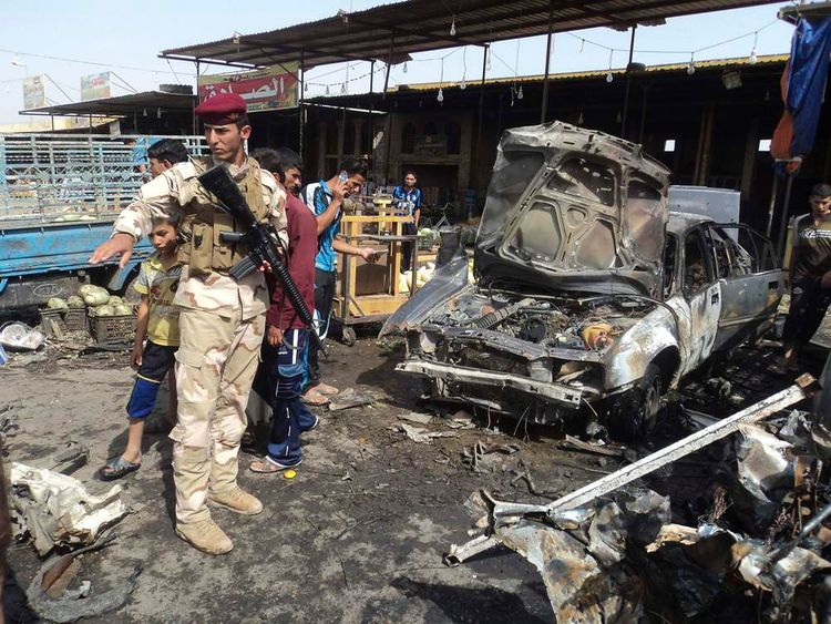 An Iraqi soldier inspects the site of one of the attacks in Kerbala