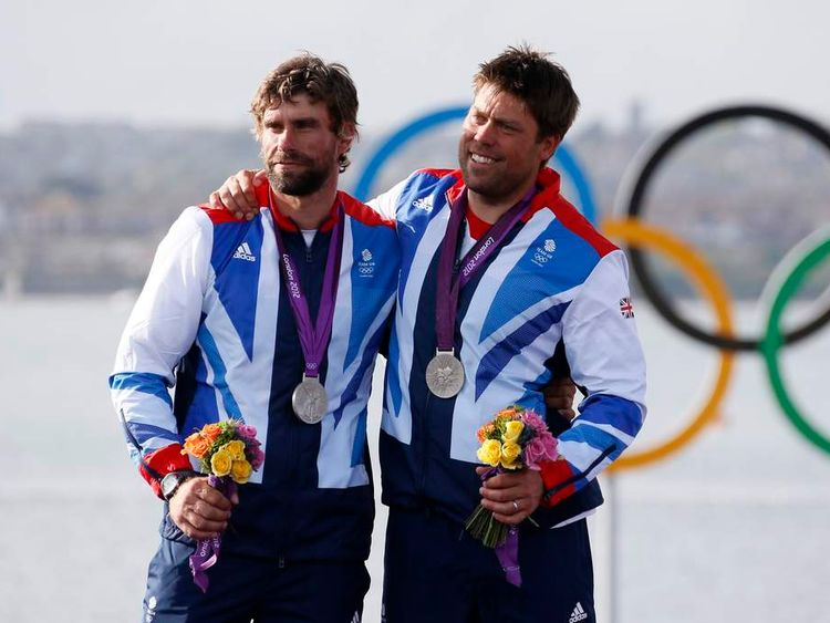 Andrew Simpson (R) celebrates winning a silver medal at the 2012 Olympic Games