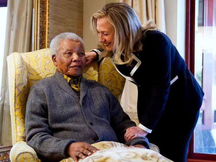 U.S. Secretary of State Hillary Clinton meets with Nelson Mandela at his home in Qunu