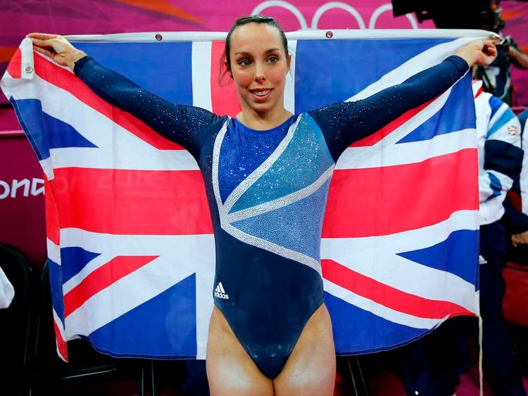 Elizabeth Tweddle of Britain celebrates winning a bronze medal in the women's gymnastics asymmetric bars final in the North Greenwich Arena during the London 2012 Olympic Games