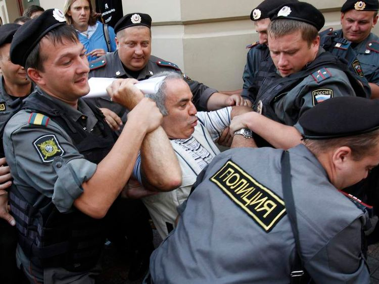 "Police detain former world chess champion and opposition leader Garry Kasparov (C) during the trial of the female punk band ""Pussy Riot"" outside a court building in Moscow,"