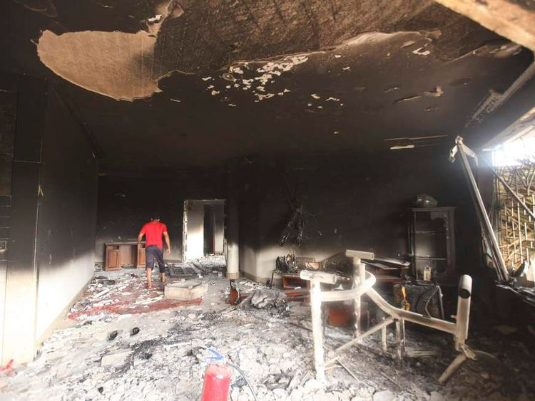 A man walks inside the U.S. consulate, which was attacked and set on fire by gunmen yesterday, in Benghazi September 12, 2012.