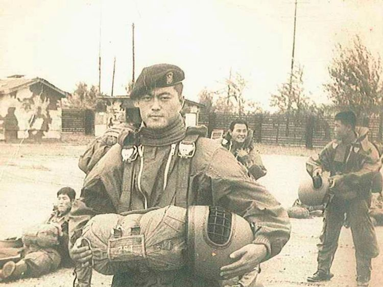 Moon Jae-in poses during his military service as a Special Forces soldier