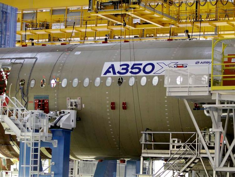 The main body section of the first Airbus A350 is seen on the final assembly line in Toulouse
