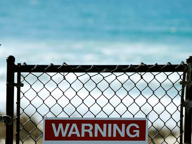 Sign on beach in California after fatal shark attack
