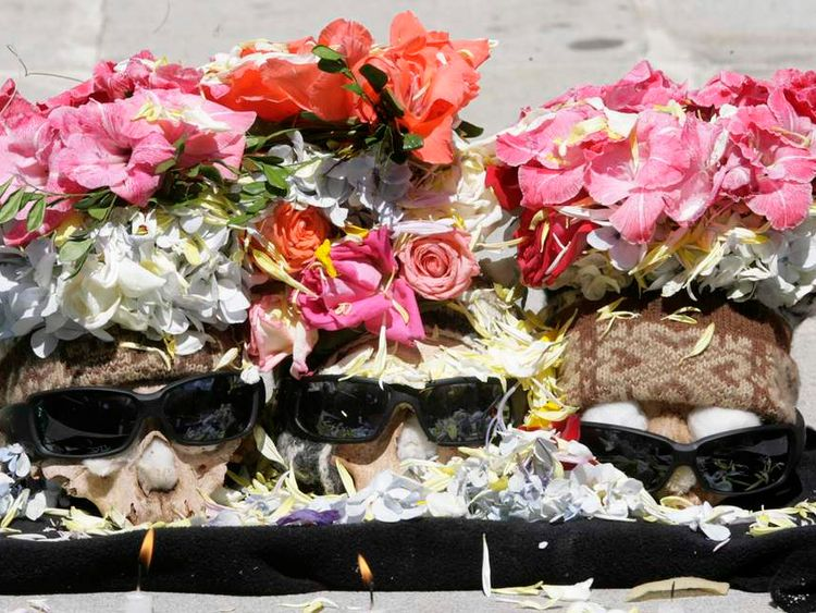 "Decorated skulls are seen during a Dia de los natitas (""Day of the Skulls"") ceremony"
