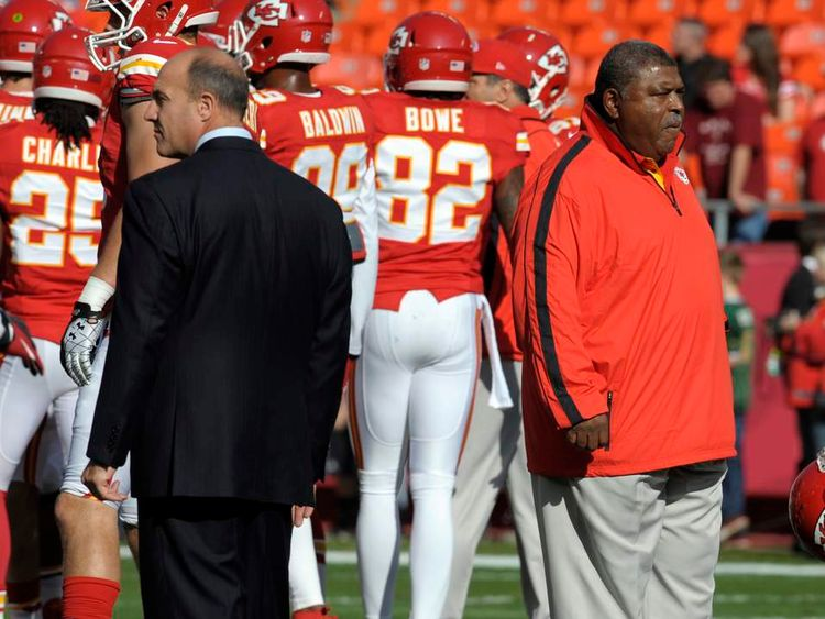 Crennel and Pioli, witnesses to suicide, watch their team before a NFL football game in Kansas City, Missouri