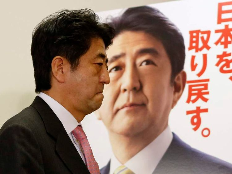 Japan's next PM Shinzo Abe attends a news conference in Tokyo